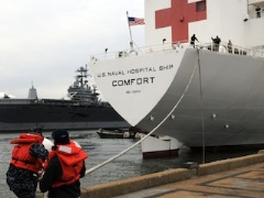 090401-N-9985W-034 NORFOLK, Va. (April 1, 2009) ? Sailors assigned to the aircraft carrier USS George H.W. Bush (CVN 77) handle lines for the hospital ship USNS Comfort (T-AH 20) as it deploys from Naval Station Norfolk for a four-month deployment to the U.S. Southern Command area of focus in support of U.S. Naval Forces Southern Command and U.S. Fourth Fleet?s Continuing Promise 2009 (CP09) to provide the region a mobile, flexible and rapidly responsive afloat medical capability for a number of missions and training opportunities in the Caribbean, Central and South America. U.S. Navy photo by Mass Communication Specialist 3rd Class Tyler J. Wilson.